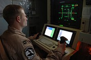 Electronics Photos - An Air Force Officer Maneuvers An by Everett