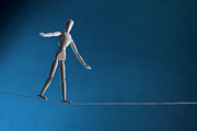 Sports Male Posters - An Artists Figure Walking A Tightrope Poster by Larry Washburn