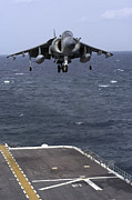 Landing Gear Posters - An Av-8b Harrier Ii Prepares To Land Poster by Stocktrek Images