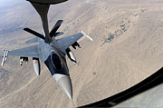 Mechanism Photo Prints - An F-16 Fighting Falcon Receives Fuel Print by Stocktrek Images