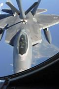 An F-22 Raptor Receives Fuel Print by Stocktrek Images