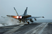 Exhaust Framed Prints - An Fa-18 Hornet Launches Framed Print by Stocktrek Images