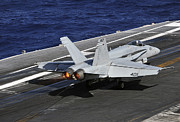 Carrier Posters - An Fa-18c Hornet Lands On The Flight Poster by Stocktrek Images