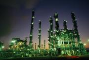 Industry And Production Art - An Oil Refinery At Dusk by Lynn Johnson