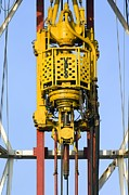 Oil Pumps Prints - An Oil-rig Drilling Derrick Print by Duncan Shaw