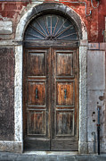 Old Door Photos - an old wooden door in Italy by Joana Kruse