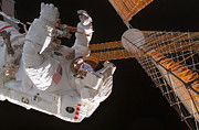 Space Exploration Art - Astronaut Works With The Port Overhead by Stocktrek Images