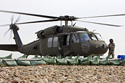 Uh-60 Black Hawk Prints - Balad, Iraq - A Uh-60l Black Hawk Lands Print by Terry Moore