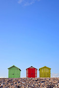 Beach Huts Framed Prints - Beach huts and blue sky Framed Print by Richard Thomas