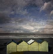 Little Cabin Prints - Beach huts under a stormy sky vintage-look. Normandy. France Print by Bernard Jaubert