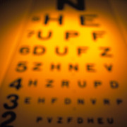 Communicating Photos - Blurred View Of A Snellen Eye Test Chart by Tek Image