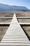 Rimrock Photos - Boat Dock on Dry Lakebed by Paul Edmondson