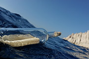 Floating In Water Prints - Bottle containing message floating in sea Print by Sami Sarkis