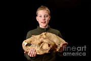 Kodiak Island Prints - Boy Holding Kodiak Bear Skull Print by Ted Kinsman
