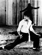 Bruce Lee Photos - Bruce Lee (1940-1973) by Granger