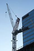 Crane Metal Prints - Building crane Metal Print by Blink Images