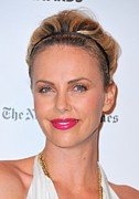 Pink Lipstick Photo Framed Prints - Charlize Theron Wearing A Jennifer Behr Framed Print by Everett