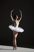 En Pointe Framed Prints - Classical Ballerina On Point Framed Print by Nisian Hughes