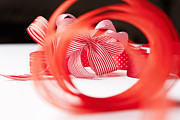 On Paper Photos - Close Up Of Decorative Red Ribbons by Nils Hendrik Mueller