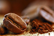 Food Still Life Photos - Coffee beans and ground coffee by Elena Elisseeva
