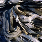 Conscious Metal Prints - Compressed pile of paper products Metal Print by Bernard Jaubert