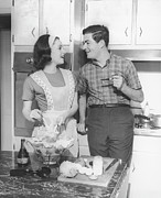 30-39 Years Framed Prints - Couple Standing In Kitchen, Smiling, (b&w) Framed Print by George Marks