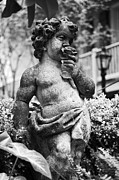 Travelpixpro Posters - Courtyard Statue of a Cherub French Quarter New Orleans Black and White Poster by Shawn OBrien