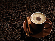 Coffee Beans Photos - Cup of Coffe Latte on Coffee Beans by Oleksiy Maksymenko