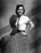 Plaid Skirt Framed Prints - Debbie Reynolds In The 1950s Framed Print by Everett