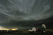 Tornadoes Photo Posters - Doppler On Wheels Radar Trucks Wait Poster by Carsten Peter