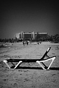Kypros Framed Prints - Empty Sun Lounger On Cyprus Tourist Organisation Municipal Beach In Larnaca Bay Republic Of Cyprus Framed Print by Joe Fox