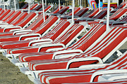 Menton Prints - Empty Sun Loungers On A Beach Print by Cornelia Doerr