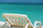 Outdoor Chair Posters - Empty white deck chair on a beach Poster by Sami Sarkis