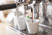 Shot Glass Prints - Espresso Machine Pouring Cups Of Coffee Print by Cultura/Nils Hendrik Mueller