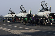 Jet Fighter Photo Posters - F-14d Tomcats On The Flight Deck Of Uss Poster by Gert Kromhout