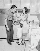 35-39 Years Posters - Family With Daughter (2-3) Preparing Food In Kitchen Poster by George Marks