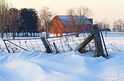 Snow Drifts Prints - Farm Gate and Barn in Winter at Sunrise Print by Gordon Wood