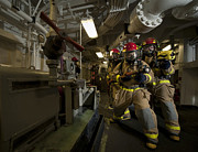 Unity Art - Firemen Combat A Simulated Fire Aboard by Stocktrek Images