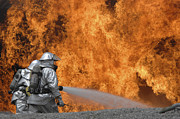 Protective Fire Framed Prints - Firemen Neutralize A Fire Framed Print by Stocktrek Images