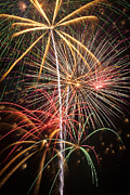 Pyrotechnic Photos - Fireworks exploding  by Garry Gay