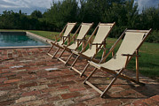 Pool Break Prints - Four Deck Chairs Await Visitors Print by Heather Perry