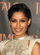 Updo Photo Posters - Freida Pinto At Arrivals For Immortals Poster by Everett