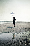 Sad Posters - Girl on the beach with parasol Poster by Joana Kruse