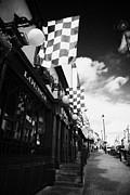 Checked Prints - Green And Yellow Donegal Colours Flags Outside Bar On Main Street Letterkenny County Donegal Print by Joe Fox