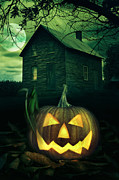 Haunted House Greeting Card Posters - Halloween pumpkin in front of a Spooky house Poster by Sandra Cunningham