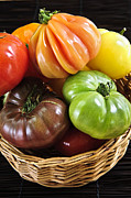 Basket Prints - Heirloom tomatoes Print by Elena Elisseeva