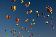Urban Scenes Prints - Hot Air Balloons Fly In A Hot Air Print by Ralph Lee Hopkins