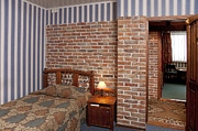 Side Table Prints - Hotel Bedroom Interior With Brick Walls Print by Jaak Nilson