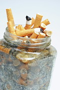 Excess Prints - Jar overflowing with cigarette butts Print by Sami Sarkis