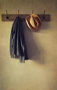 Coat Hanger Framed Prints - Jean shirt and straw hat hanging on hooks Framed Print by Sandra Cunningham
